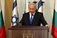 The gap between Israel and the United States on Iran widened Sunday as Benjamin Netanyahu, pictured on September 11, insisted on a &quot;red line&quot; from Washington, claiming Tehran is &quot;90 percent&quot; toward having a nuclear bomb
