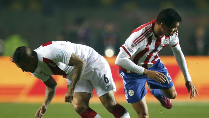 Peru's Vargas challenges Paraguay's Caceres during their Copa America 2015 third-place soccer match at Estadio Municipal Alcaldesa Ester Roa Rebolledo in Concepcion