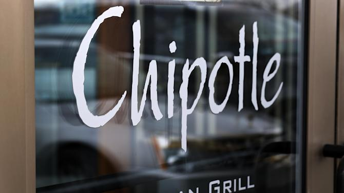 This Tuesday, Jan. 28, 2014, photo, shows the door on a Chipotle Mexican Grill in Robinson Township, Pa. Chipotle reports quarterly earnings on Thursday, Jan. 30, 2014. (AP Photo/Gene J. Puskar)