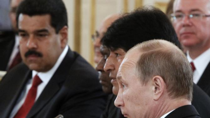 Russian President Vladimir Putin, front, Bolivian President Evo Morales, second right, and Venezuelan President Nicolas Maduro, left, attend the Gas Exporting Countries Forum (GECF) in the Kremlin in Moscow, Monday, July 1, 2013. (AP Photo/Maxim Shemetov, Pool)