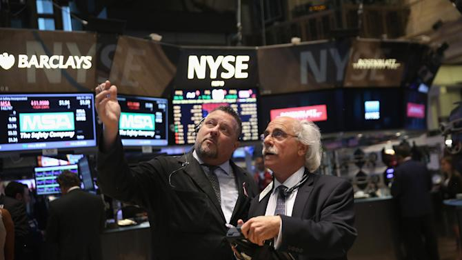 Traders work the floor of the New York Stock Exchange on July 31, 2014