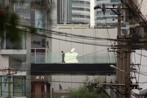 "<p>A man walks on a footbridge in front of an Apple store in Beijing. A labour rights group said Thursday it had found ""deplorable"" conditions at Apple suppliers in China, following a probe of several firms that make the US technology giant's hugely popular products.</p>"