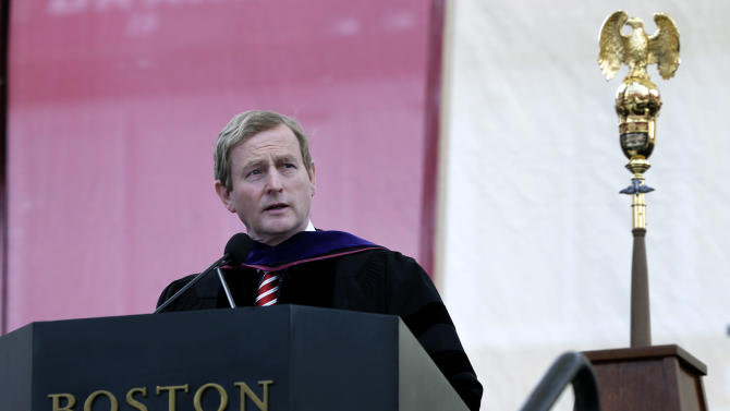 Irish Prime Minister Enda Kenny speaks to graduates at Boston College after receiving an honorary Doctor of Laws degree during commencement ceremonies at Alumni Stadium in Boston, Monday, May 20, 2013. (AP Photo/Elise Amendola)