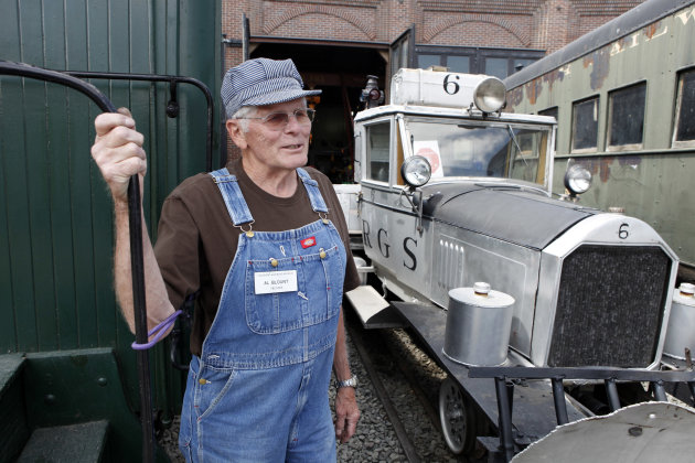 In this May 31, 2012 photo Al Blount a volunteer at the Colorado Railroad Museum in Golden, Colo., stands beside Golden Goose #6 as he talks about the history of the converted automobiles. Six out of seven of the Galloping Geese that were built by the railroads in the 1930s are scheduled to be on display at the museum this weekend. (AP Photo/Ed Andrieski)