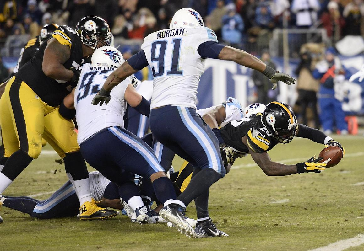 Pittsburgh Steelers running back Le'Veon Bell (26) scores a touchdown on a 5-yard run against Tennessee Titans defenders Mike Martin (93) and Derrick Morgan (91) in the second half of an NFL football game Monday, Nov. 17, 2014, in Nashville, Tenn