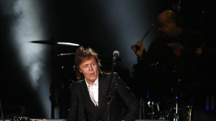 "British musician Paul McCartney performs during his show ""Out there"" in Montevideo"