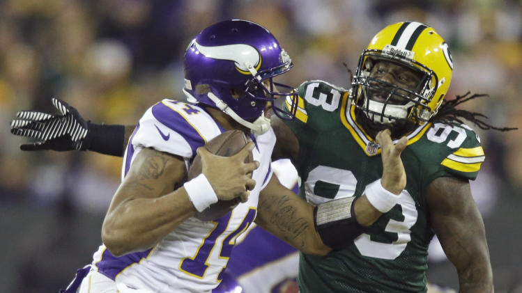 Green Bay Packers outside linebacker Erik Walden (93) sacks Minnesota Vikings quarterback Joe Webb (14) during the first half of an NFL wild card playoff football game Saturday, Jan. 5, 2013, in Green Bay, Wis. (AP Photo/Jeffrey Phelps)