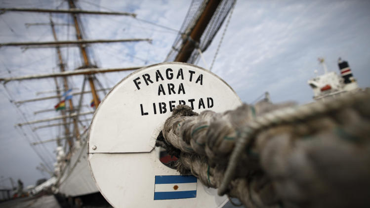 The three-masted ARA Libertad, a symbol of Argentina's navy, docked at the port in Tema, outside Accra, Ghana, Tuesday, Oct. 23, 2012. Argentina has hired an Air France charter to fly nearly 300 navy cadets home from Ghana after failing to persuade the government there to reverse the seizure of its tall ship. Argentina said Monday that 281 crew members from Argentina and a half-dozen other countries will fly to Buenos Aires on Wednesday, leaving the captain with a skeleton crew to maintain the ship at port in Ghana.(AP Photo/Gabriela Barnuevo)