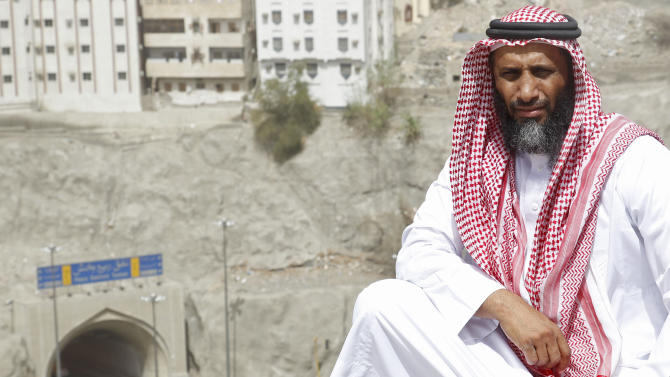 Ahmed Zuhair poses for a picture in the holy city of Mecca, Saudi Arabia, Friday, June 14, 2013. Until he was released from U.S. custody in 2009, Zuhair and another prisoner had the distinction of staging the longest hunger strikes at the Guantanamo prison. Zuhair kept at it for four years in a standoff that at times turned violent.  Zuhair, a former sheep merchant who was never charged with any crime during seven years at Guantanamo, stopped eating in June 2005 and kept up his protest until he was sent home to Saudi Arabia in 2009. (AP Photo)