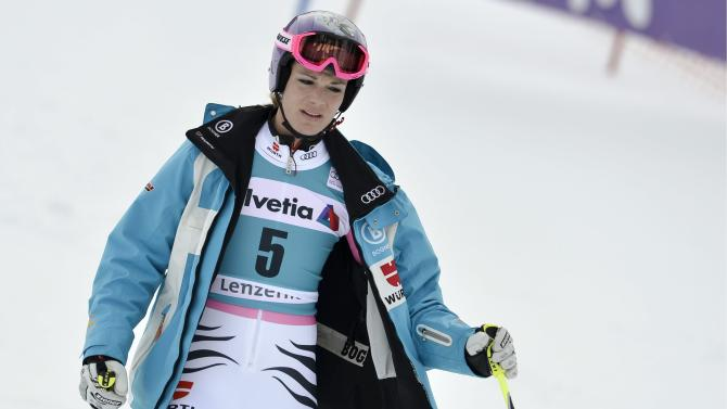 Maria Hoefl-Riesch of Germany reacts afters she bowed out during the 1st run of the women's World Cup Giant Slalom at the FIS Alpine Ski World Cup finals, in Parpan - Lenzerheide, Switzerland, Sunday, March 17, 2013. (AP Photo/Keystone/Peter Schneider)