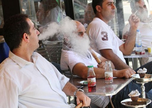 Lebanese men smoke at an outdoor cafe in Beirut. A smoking ban in all closed public spaces, including coffee shops, restaurants and bars, went into force in Lebanon on Monday under new legislation that promises hefty fines for lawbreakers