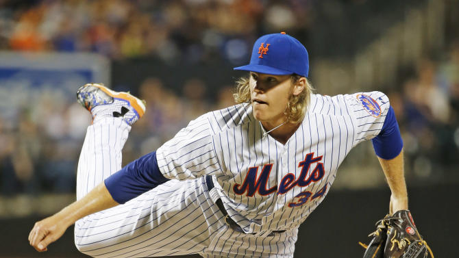 New York Mets starting pitcher Noah Syndergaard delivers during the second inning of a baseball game against the Washington Nationals in New York, Sunday, Aug. 2, 2015. (AP Photo/Kathy Willens)