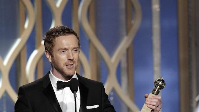 "This image released by NBC shows Damian Lewis, winner of the award for best actor in a TV drama series for his role in ""Homeland,"" on stage during the 70th Annual Golden Globe Awards held at the Beverly Hilton Hotel on Sunday, Jan. 13, 2013, in Beverly Hills, Calif. (AP Photo/NBC, Paul Drinkwater)"