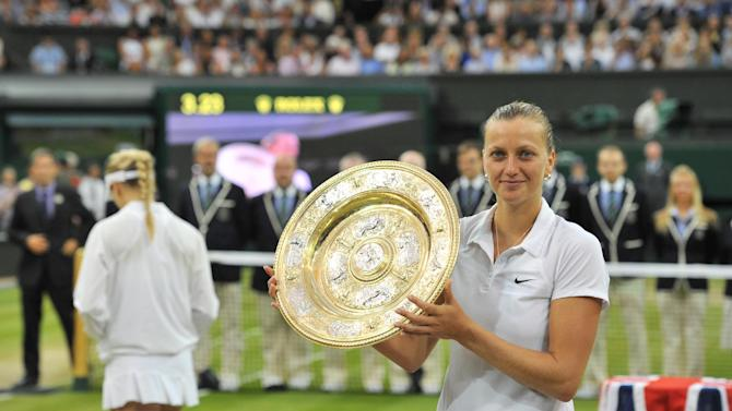 Petra Kvitova holds the winner's Venus Rosewater Dish during the trophy presentation after beating Eugenie Bouchard in the women's singles final at the Wimbledon Champioships at The All England Tennis Club in southwest London, on July 5, 2014