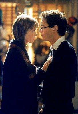 "Larry (Robert Downey Jr., R) and Ally (Calista Flockhart, L) try to figure out where their relationship stands following a surprise visit by his ex-girlfriend on ""The Man With The Bag"" episode of Ally McBeal Ally McBeal"