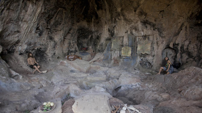 This Wednesday, Oct. 9, 2013 photo shows the stone age recycling site cave at the north of Israel next to the city of Zichron Yaakov. There is mounting evidence that already hundreds of thousands of years ago our prehistoric ancestors learned to recycle the objects they used in their daily lives, say researchers gathered here for an international conference. (AP Photo/Dan Balilty)