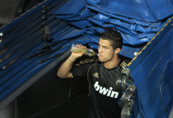 Real Madrid's Cristiano Ronaldo from Portugal quenches his thirst before their Santiago Bernabeu Trophy soccer match against Galatasaray at the Santiago Bernabeu stadium in Madrid, Wednesday, Aug. 24, 2011. (AP Photo/Arturo Rodriguez)