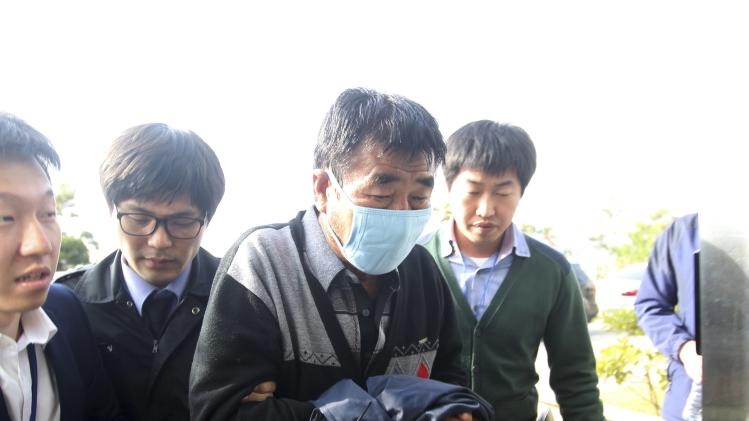 Lee, captain of the sunken South Korean ferry Sewol, arrives at the headquarters of a joint investigation team of prosecutors and police in Mokpo
