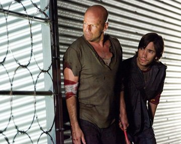 Bruce Willis and Justin Long in 20th Century Fox's Live Free or Die Hard