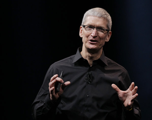 "In this Wednesday, Sept. 12, 2012 photo, Apple CEO Tim Cook speaks during an introduction of the new iPhone 5 in San Francisco. Cook says the company is ""extremely sorry"" for the frustration that its maps application has caused and it's doing everything it can to make it better. Cook said in a letter posted online Friday Sept. 28, 2012 that Apple ""fell short"" in its commitment to make the best possible products for its customers. (AP Photo/Eric Risberg)"