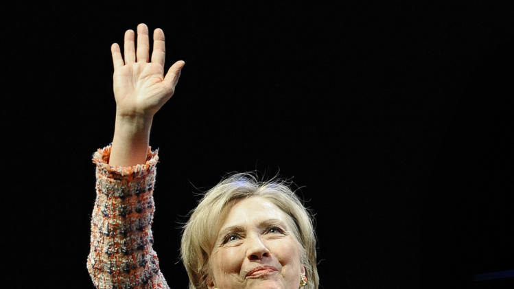 Former Secretary of State Hillary Rodham Clinton waves to an audience as she is introduced as a keynote speaker at the Edmund Fusco Contemporary Issues Forum at the University of Connecticut, Wednesday, April 23, 2014, in Storrs, Conn. (AP Photo/Jessica Hill)