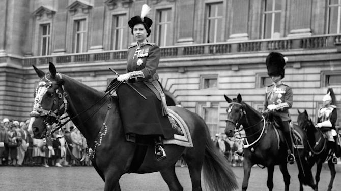 FILE This June 15, 1960 file photo shows Queen Elizabeth II, riding out from Buckingham Palace, London to take the salute at the ceremony of Trooping the Colour, followed by Prince Philip and with him is the Duke of Gloucester, the Queen's uncle.  Queen Elizabeth II kicks off a long weekend of celebrations of her 60-year reign by going to the races, and perhaps no other event will give her so much pleasure. The Epsom Derby is the richest event on Britain's horse-racing calendar, and never mind that this is      the only major race in which the queen has never entered a winner. Pleasure, in the gilded life of Queen Elizabeth II, often comes on four hooves.(AP Photo, File)