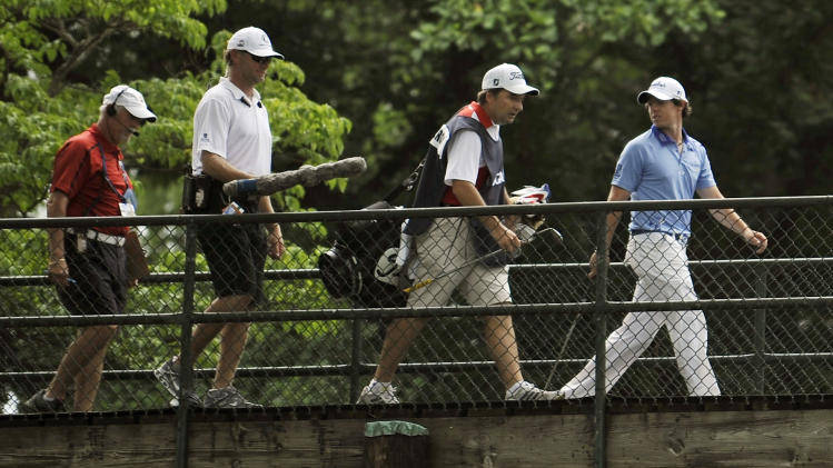 Rory McIlroy, of Northern Ireland, walks across the bridge to the tenth tee during the final round of the U.S. Open Championship golf tournament in Bethesda, Md., Sunday, June 19, 2011. (AP Photo/Nick Wass)