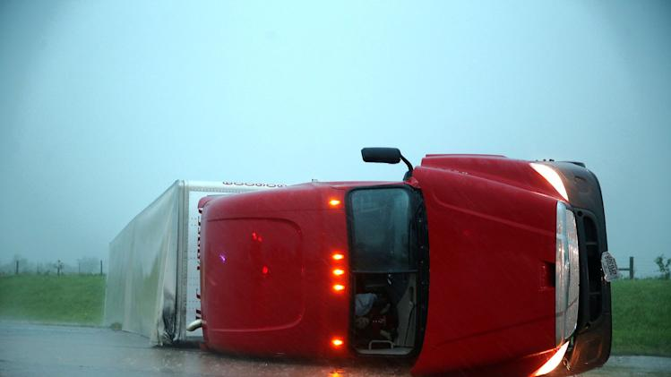 An overturned semitrailer rests on its side on the eastbound lanes of Interstate 40, just east of El Reno, Okla., after a reported tornado touched down, Friday, May 31, 2013. (AP Photo/The Omaha World-Herald, Chris Machian) MANDATORY CREDIT