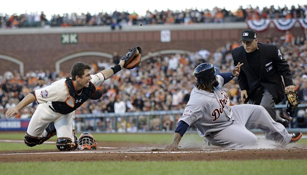 Detroit Tigers&#39; Prince Fielder is tagged out at home plate by San Francisco Giants&#39; Buster Posey, left, during the second inning of Game 2 of baseball&#39;s World Series Thursday, Oct. 25, 2012, in San Francisco. Umpire Dan Iassogna makes the call at the plate. (AP Photo/Marcio Jose Sanchez)