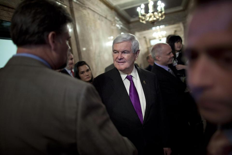 Republican presidential candidate, former House Speaker Newt Gingrich shakes hands during a visit to the state capital on Friday, Feb. 24, 2012 in Olympia, Wash.  (AP Photo/Evan Vucci)
