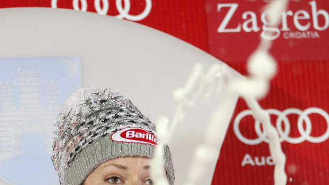 Mikaela Shiffrin, of the United States, sprays champagne as she celebrates on the podium after winning an alpine ski, women's World Cup slalom, in Zagreb, Croatia, Friday, Jan. 4, 2013. (AP Photo/Darko Bandic)
