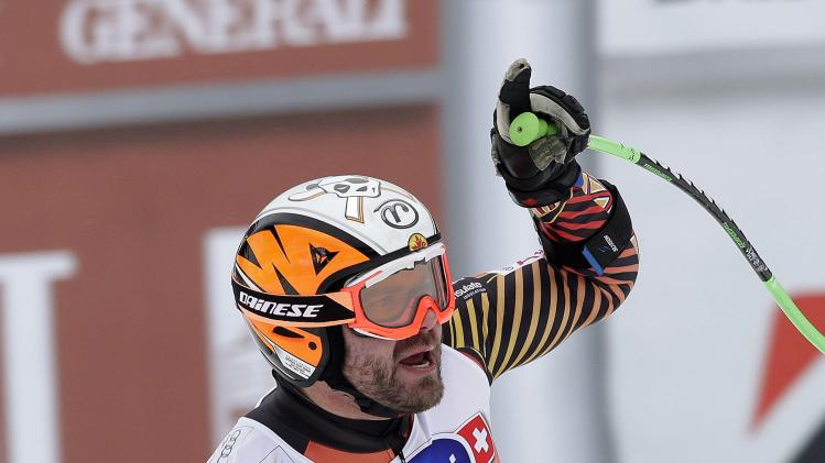 Jan Hudec of Canada celebrates his second place finish in the men's World Cup Super-G skiing race in Val Gardena
