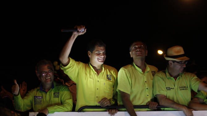 Ecuador's President and candidate for re-election Rafael Correa, second from the left, and vice presidential candidate Jorge Glass, third from the left, greet supporters during a rally in Guayaquil, Ecuador, Wednesday, Feb. 13, 2013. Presidential elections in Ecuador are scheduled for Feb. 17. (AP Photo/Dolores Ochoa)
