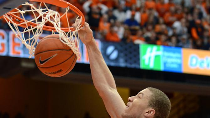 Syracuse's Brandon Triche dunks against St. John's during the second half of an NCAA college basketball game in Syracuse, N.Y., Sunday, Feb. 10, 2013. Syracuse won 77-58. (AP Photo/Kevin Rivoli)
