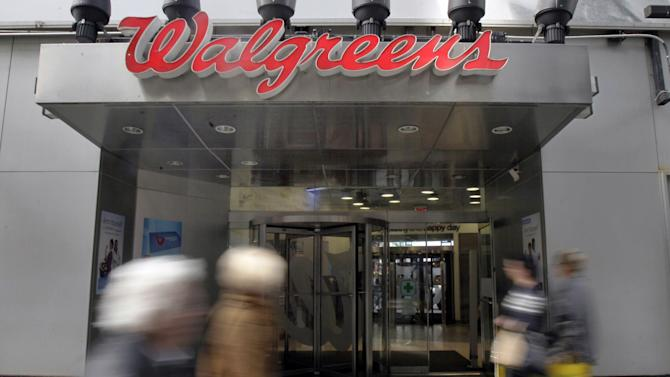 In this Wednesday, Oct. 17, 2012 photo, people pass the Walgreens store in New York's Times Square. Walgreen Co.'s fiscal first-quarter earnings sank nearly 26 percent as the nation's largest drugstore chain filled fewer prescriptions and absorbed costs tied to acquisitions and Superstorm Sandy. The Deerfield, Ill., company's performance fell short of Wall Street expectations, and the stock slipped Friday, Dec. 21, 2012, before markets opened. (AP Photo/Richard Drew)