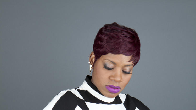 "This April 24, 2013 photo shows American R&B singer Fantasia Barrino posing for a portrait to promote her new album ""Side Effects of You,"" in New York. (Photo by Amy Sussman/Invision/AP)"