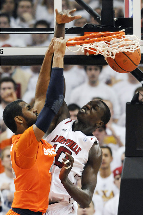 Syracuse's James Southerland, left, dunks on Louisville's Gorgui Dieng during the second half of their NCAA college basketball game, Monday, Feb. 13, 2012, in Louisville, Ky. Syracuse won 52-51. (AP P