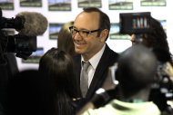 American actor Kevin Spacey speaks to the press as he arrives for the premiere of &quot;Spirit Of A Denture&quot; in Johannesburg, South Africa, Saturday, May 12, 2012. Spacey spoke about his international outlook during a brief visit to Johannesburg for the premiere of the South African short film he helped produce and in which he stars. (AP Photo/Denis Farrell)