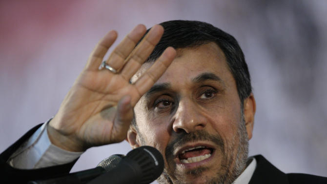 FILE - In this June 2, 2012 photo, Iranian President Mahmoud Ahmadinejad gestures as he delivers a speech on the eve of the 23rd death anniversary of late revolutionary founder Ayatollah Khomeini, at his mausoleum just outside Tehran, Iran. Lawmakers are working on a set of new and unprecedented Iran sanctions that could prevent the Islamic republic from doing business with most of the world until it agrees to international constraints on its nuclear program, officials say. (AP Photo/Vahid Salemi, File)