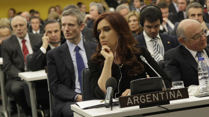 Argentine President Cristina Fernandez de Kirchner listens as members of the Legislative Assembly of the Falkland Islands Government addresses the Special Committee on the Situation with regard to the Implementation of the Declaration on the Granting of Independence to Colonial Countries and Peoples,  Thursday, June 14, 2012 at United Nations headquarters. Argentina's president is pressing her country's claim to the Falkland Islands with a high-profile appearance Thursday before a little-known U.N. committee on the 30th anniversary of Britain's ouster of an Argentine invasion force. (AP Photo/Mary Altaffer)
