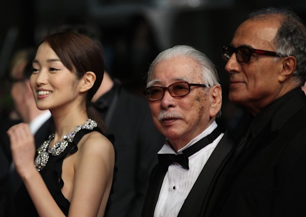 From left, actors Rin Takanashi, Tadashi Okuno and director Abbas Kiarostami arrive for the screening of Like Someone in Love at the 65th international film festival, in Cannes, southern France, Monday, May 21, 2012. (AP Photo/Joel Ryan)