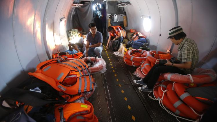 Life vests and lifesavers are seen onboard an aircraft to find the missing Malaysia Airlines flight MH370, off Tho Chu island