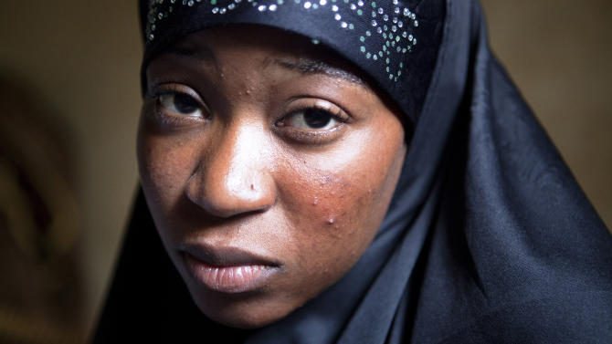 In this Oct. 10, 2012 photo, Lalla Arby, 22, who was beaten by Islamist group Ansar Dine for sitting outside her home in Timbuktu with her head uncovered, poses for a picture in a headscarf in Bamako, Mali, where she now lives with relatives. In recent months, al-Qaida and its allies have taken advantage of political instability within Mali to push out of their hiding place and into the towns, taking over an enormous territory which they are using to stock arms, train forces and prepare for global jihad. And as 2012 draws to a close and the world hesitates, delaying a military intervention, the extremists who seized control of the area earlier this year are preparing for a war they boast will be worse than the decade-old struggle in Afghanistan. (AP Photo)