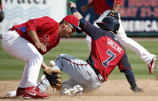 Philadelphia Phillies shortstop Andres Blanco bobbles the throw as Atlanta Braves' Tyler Greene (7) slides safely into second on a seventh-inning stolen base in a spring exhibition baseball game i