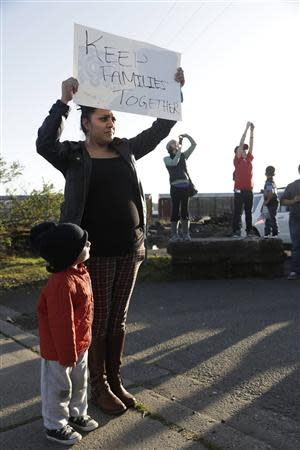 Immigrants rights supporters rally outside the US Immigration Customs Enforcement (ICE) Northwest Detention Center in Tacoma, Washington