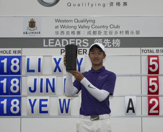 Handout picture shows Chinese golfer Ye holding his trophy after round two of the Volvo China Open Western China Qualifying in Chengdu