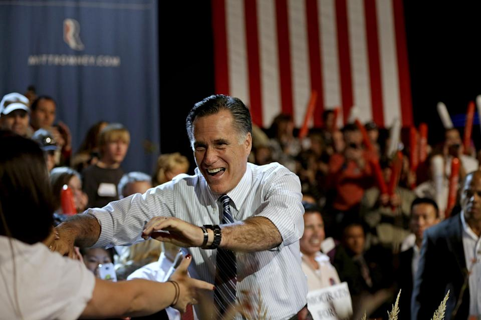 Republican presidential candidate, former Massachusetts Gov. Mitt Romney, greets supporters as he takes the stage for a campaign event at the Red Rocks Amphitheatre Tuesday, Oct. 23, 2012, in Golden, Colo. (AP Photo/David Goldman)