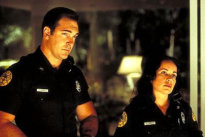 Patrick Warburton and Janeane Garofalo in Touchstone's Big Trouble