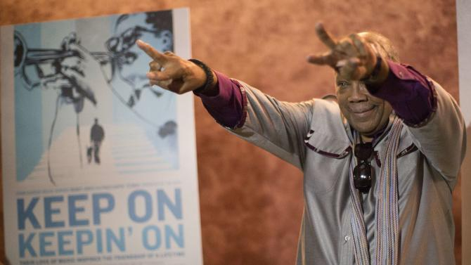 "Cast member Quincy Jones gestures at the premiere of the documentary ""Keep on Keepin' On"" at The Landmark theatre in Los Angeles"