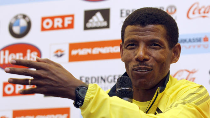"""File- In this photo taken Friday, April 12, 2013 Ethiopia's long distance runner and marathon world record holder Haile Gebrselassie speaks during a news conference ahead of the Vienna city marathon in Vienna, Austria. Gebrselassie says that he is entering politics and may run for president of Ethiopia, even if some closest to him, including members of his own family, are against it. The two-time Olympic gold medalist and multiple world champion in the 10,000 meters, who set over two dozen distance world records in his career, tells The Associated Press he wants to """"reach more people"""" through politics, a topic most Ethiopians avoid at all costs in a restrictive society with few civil liberties. (AP Photo/Ronald Zak, file)"""